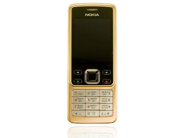obsah balení NOKIA 6300 Gold 512MB + pouzdro Krusell Classic